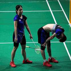 National badminton athletes Goh Soon Huat (right) and Shevon Lai reacts after their defeat at the SEA Games 2019 in Manila, today — Bernama
