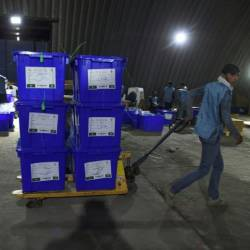 The young employees at Afghanistan's Independent Electoral Commission are rushing through final preparations for the vote, set for September 28. — AFP
