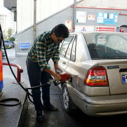 Iranians fill their vehicles at a petrol station in Tehran, on Nov 15. — AFP