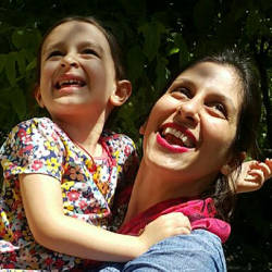 A handout picture released by the Free Nazanin campaign on August 23, 2018 shows Nazanin Zaghari-Ratcliffe (R) embracing her daughter Gabriella in Damavand, Iran. — AFP