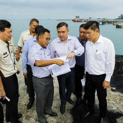 Transport Minister Anthony Loke Siew Fook (3rd R) listens to a briefing by the Railway Assets Corporation (RAC) manager Datuk Baharin Datuk Abdul Hamid (4th R), on May 24, 2019. — Bernama