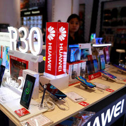 An employee sells Huawei P30 handset in a shopping centre in Bangkok, Thailand May 22, 2019. — Reuters