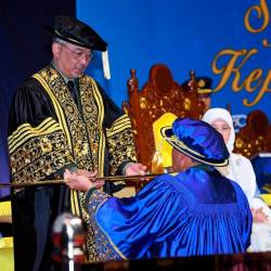 Yang di-Pertuan Agong Al-Sultan Abdullah Ri'ayatuddin Al-Mustafa Billah Shah receives the instrument of appointment was presented to His Majesty by Defence Minister Mohamad Sabu at the university's 10th convocation ceremony at the Putrajaya International Convention Centre. - Bernama