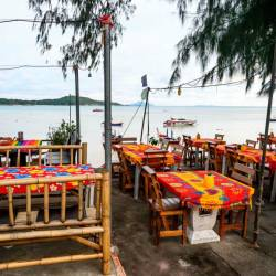 In this file photo taken on October 02, 2019, a couple sit at a restaurant on Raway beach on Phuket island. - AFP