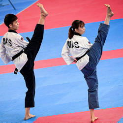 National Taekwondo atheletes Nurul Hidayah and Jason Loo at the Recognized Poomsae event at the SEA Games 2019 in Manila, today — Bernama