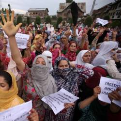 Kashmiri women shout slogans at a protest after Friday prayers during restrictions after the Indian government scrapped the special constitutional status for Kashmir, in Srinagar Aug 16. — Reuters
