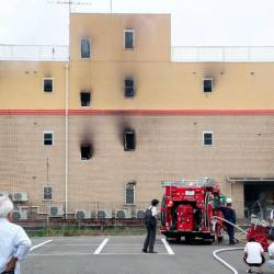 Fire fighters inspect an animation company which caught fire in Kyoto on July 18, 2019. A fire at an animation company in Japan's Kyoto on July 18 killed one person and injured dozens more, several of them seriously, a fire department spokesman said. — AFP