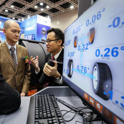 Deputy International Trade and Industry Minister Dr Ong Kian Ming (C) listens to a briefing during the 11th Automechanika Kuala Lumpur, on March 21, 2019. — Sunpix by Amirul Syafiq Mohd Din