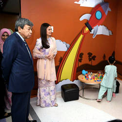 Sultan of Selangor Sultan Sharafuddin Idris Shah (left) and Tengku Permaisuri Selangor Tengku Permaisuri Norashikin during their visit to the Child Treatment Unit after officiating the Avisena Women's and Children's Specialist Hospital in Shah Alam today. — Bernama