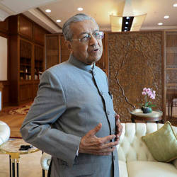 Prime Minister Tun Dr Mahathir Mohamad reacts during an interview with Reuters in Putrajaya, Malaysia, Dec 10, 2019 — Reuters
