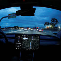 A Model 3 Tesla vehicle navigates morning rush hour using the car's auto pilot feature in Los Angeles — Reuters
