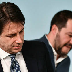 In this file photograph taken on January 14, 2019, shows Italy's Prime Minister Giuseppe Conte (L) and Italy's Interior Minister and deputy PM Matteo Salvini attending a press conference at Palazzo Chigi in Rome. — AFP