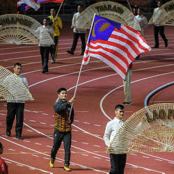 Loh Jack Chang, former Malaysian wushu athlete carries the Malaysian flag at the SEA Games 2019 closing ceremony in New Clark City yesterday — Bernama