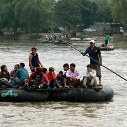 Migrants board rafts to cross the Suchiate river from Guatemala to Mexico, as Mexico races to implement a deal with Washington to curb undocumented migration. — AFP
