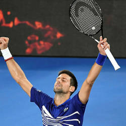Serbia's Novak Djokovic celebrates his victory against Russia's Daniil Medvedev during their men's singles match on day eight of the Australian Open — AFP
