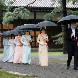 Japan's Crown Prince Akishino (R), his wife Crown Princess Kiko (2nd R) and other members of the imperial family arrive at the Imperial Palace sanctuaries where Emperor Naruhito will report the proclamation of his ascension to the throne in Tokyo on Oct 22, 2019. — AFP