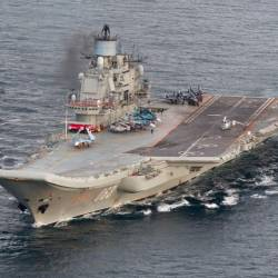 A file handout photograph taken and released by the Norwegian Armed Forces Forsvaret on Oct 17, 2016 shows the Russian aircraft carrier Admiral Kuznetsov passing the Norwegian island of Andoya in the international waters on its way to the mediterranean sea. — AFP