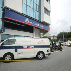 Two men run away with RM230,000 after robbing a security van at a bank in Jalan Tun Dr Awang at noon today. — Bernama