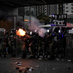 Police fire tear gas in Tseun Wan in Hong Kong on Aug 25, 2019 in the latest opposition to a planned extradition law that has since morphed into a wider call for democratic rights in the semi-autonomous city. — AFP