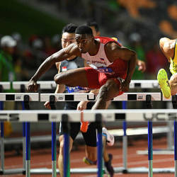 Philippines' Clinton Kingsley Bautista (C) races against Malaysia's Rayzam Shah Sofian Wan (R) in the men's 110m hurdles event at the SEA Games (Southeast Asian Games) in Clark, Capas, Tarlac province, north of Manila on Dec 9, 2019 — AFP