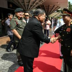 Defence Minister Mohamad Sabu (L) shakes hand with his counterpart from Laos, General Chansamone Chanyalath (2R) at Wisma Perwira, on March 23, 2019. — Bernama