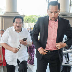 Filepix taken on July 10 shows Datuk Seri Tengku Adnan Tengku Mansor (center) arriving at the Kuala Lumpur Courts Complex. — BBXpress
