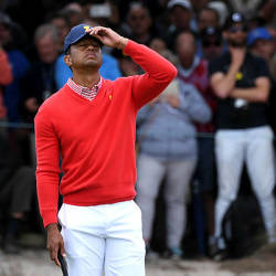 US team captain Tiger Woods reacts during day one of the Presidents Cup golf tournament in Melbourne on Dec 12, 2019 — AFP
