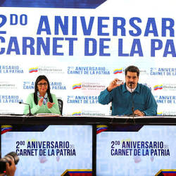 This handout picture released by the Venezuelan presidency shows Venezuelan President Nicolas Maduro (C) talking next to Vice-President Delcy Rodriguez (L) and Education Minister Aristobulo Isturiz during a television programme in Caracas — AFP