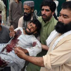 Men move an injured man after a suicide attack during an election campaign meeting, outside a hospital in Quetta, Pakistan on July 13 — Reuters