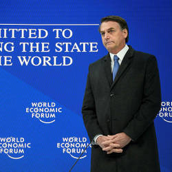 Brazilian President Jair Bolsonaro stands prior to delivering a speech during the World Economic Forum (WEF) annual meeting — AFP