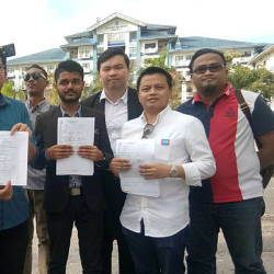The PKR Youth secretary Ahmad Syukri Che Ab Razab (second, left) showing the police reports during a press conference at Bukit Beruang yesterday. — Bernama