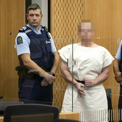 In this file photo taken on March 16, 2019 Brenton Tarrant, the man charged in relation to the Christchurch massacre, makes a sign to the camera during his appearance in the Christchurch District Court. — AFP