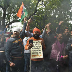 Activist of the Bajrang Dal and Vishwa Hindu Parishad (VHP) shout slogans against Pakistan during a protest in New Delhi — AFP