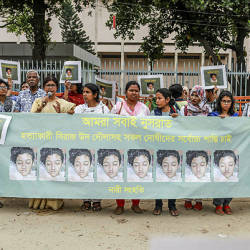 In this photo taken on April 12, 2019 Bangladeshi women hold banners and photographs of schoolgirl Nusrat Jahan Rafi at a protest in Dhaka, following her murder by being set on fire after she had reported a sexual assault. — AFP