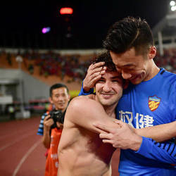 This photo shows Tianjin Quanjian's Alexandre Pato (L) and goalkeeper Zhang Lu hugging after the AFC Champions League round of 16 football match between China's Guangzhou Evergrande and Tianjin Quanjian in Guangzhou in China's southern Guangdong province. When Brazilian star Alexandre Pato jetted out of China for his holidays he played for Tianjin Quanjian. — AFP