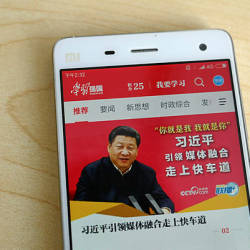 "Photo shows a phone app called ""Xuexi Qiangguo"" or ""Study to make China strong"" with an image of China's President Xi Jinping in Beijing. — AFP"