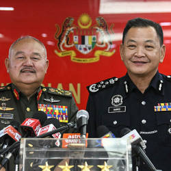 Chief of Armed Forces (ATM) Gen Tan Sri Zulkifli Zainal Abidin (left) alongside Inspector-General of Police Datuk Seri Abdul Hamid Bador at a press conference at ATM headquarters today. — Bernama