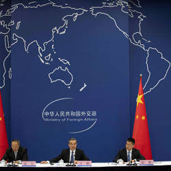 China's Foreign Minister Wang Yi (C) speaks during a press conference briefing on the Belt and Road Summit at the Ministry of Foreign Affairs in Beijing on April 19, 2019. — AFP