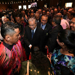 Prime Minister Tun Dr Mahathir Mohamad is greeted by guests at the 2019 Malaysian Security Services Industry Excellence Awards last night. — Bernama