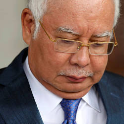 Former Prime Minister Najib Razak leaving the Kuala Lumpur High Court yesterday. — Reuters