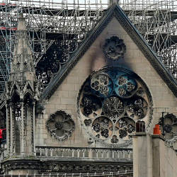 Inspectors are seen on the roof of the landmark Notre-Dame Cathedral in central Paris on April 16, 2019. — AFP