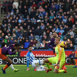 Raheem Sterling (2nd L) heads home City's second goal during against Huddersfield the John Smith's stadium ,on Jan 20, 2019. — AFP