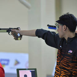 National shooter Johnathan Wong in the 10m pistol event in the Marine Corps Training Centre in Manila today — Bernama