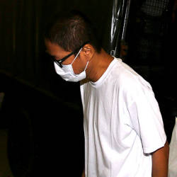 Suspect Tan Kian Ngip is brought to the magistrate court to face charges for the murder of an elderly couple in Sermenban, today — Bernama