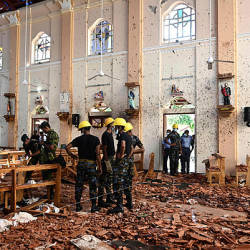 Security personnel inspect the interior of St Sebastian's Church in Negombo on April 22, 2019, a day after the church was hit in series of bomb blasts targeting churches and luxury hotels in Sri Lanka. — AFP