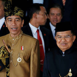 Indonesia's President Joko Widodo (front, left) and Vice President Jusuf Kalla depart after the president's address ahead of the Indonesian Independence Day in Jakarta, Indonesia, Aug 16. — Reuters