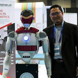 Roboprenuer Sdn Bhd Founder and CEO, Dr Hanafiah Yussof, with Adam the humanoid robot during the 2019 Beyond Paradigm Summit at Malaysian International Trade and Exhibition Centre, on July 18, 2019. — Bernama