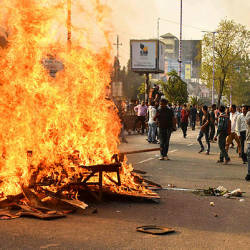 Demonstrators setup a bonfire on a street as they protest against the governments Citizenship Amendment Bill (CAB), in Guwahati on Dec 11, 2019. Authorities in India's northeast called in troops on Dec 11 as demonstrators went on the rampage in protest at new citizenship legislation expected to pass the upper house, officials said. — AFP