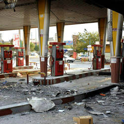 An Iranian man checks a scorched gas station that was set ablaze by protesters during a demonstration against a rise in gasoline prices in Eslamshahr, near the Iranian capital of Tehran, on November 17, 2019. — AFP