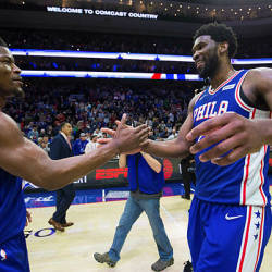 Philadelphia 76ers guard Jimmy Butler (23) and center Joel Embiid (21) celebrate a victory against the Boston Celtics at Wells Fargo Center. — Reuters